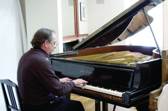 David Stanwood plays his grand piano at Pathways in Chilmark.