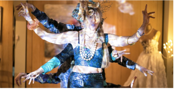 Keren Tonnesen, dressed as a mermaid, & friends doing an octopus dance – Photo by Larisa Stinga